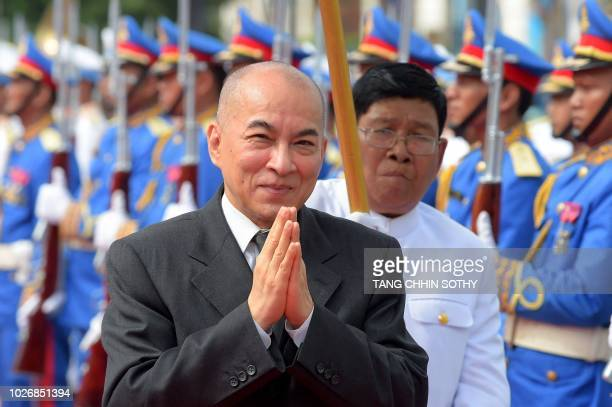 Cambodia's King Norodom Sihamoni leaves after attending the opening ceremony of the parliament at the national assembly building in Phnom Penh on...