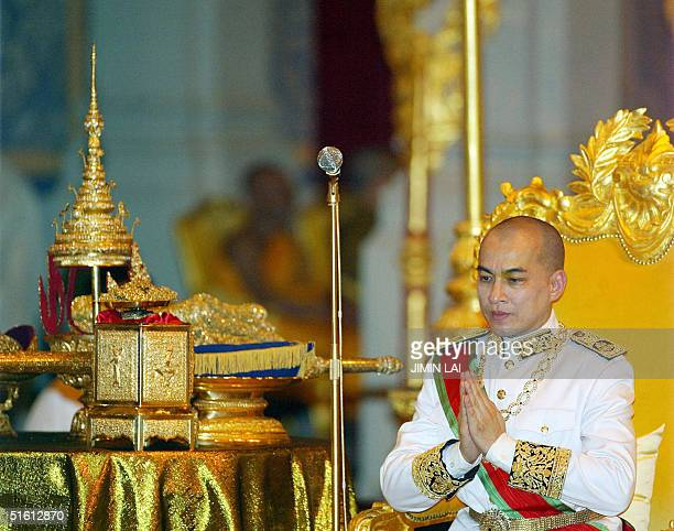 Cambodia's King Norodom Sihamoni sits on his throne beside his crown and sword during his coronation ceremony at the Royal Palace in Phnom Penh 29...