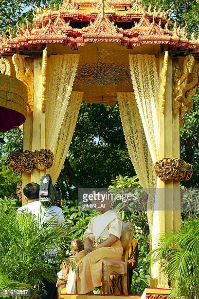 Cambodia's new King Norodom Sihamoni sits in a royal pavilion during a religious ceremony at the Royal Palace in Phnom Penh 29 October 2004...