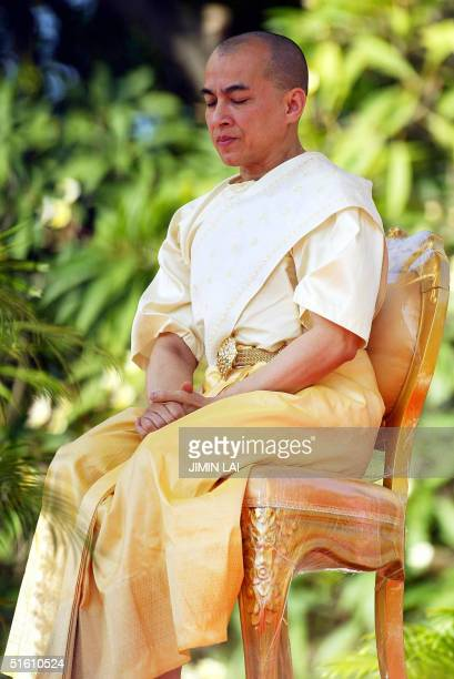Cambodia's new King Norodom Sihamoni sits on a high platform during a religious ceremony at the Royal Palace in Phnom Penh 29 October 2004...