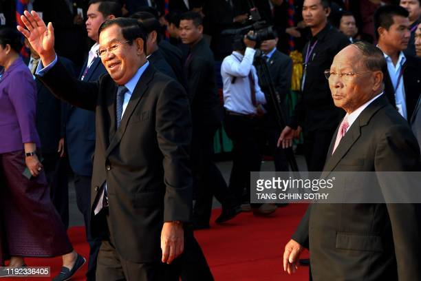 Cambodia's Prime Minister and president of the Cambodian People's Party Hun Sen gestures and President of the National Assembly Heng Samrin looks on...