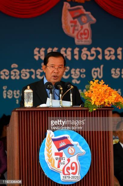 Cambodia's Prime Minister and president of the Cambodian People's Party Hun Sen addresses supporters during a ceremony marking the 41st anniversary...