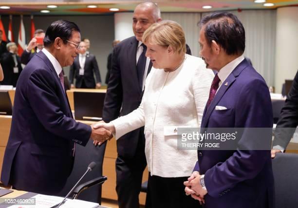 Cambodia's Prime Minister Hun Sen Bulgarian Prime Minister Boyko Borisov Chancellor of Germany Angela Merkel and Sultan of Brunei Haji Hassanal...