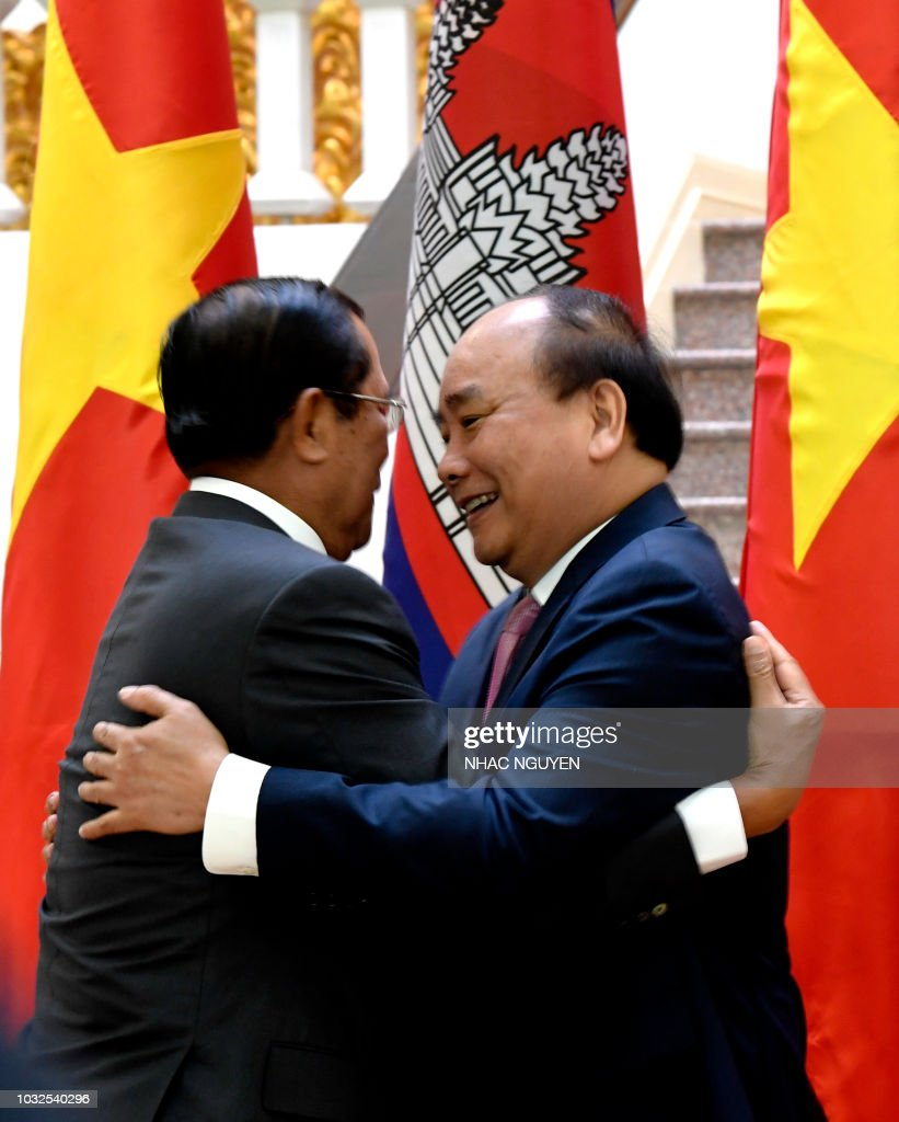 Cambodia's Prime Minister Hun Sen (L) greets Vietnam's Prime Minister Nguyen Xuan Phuc during their meeting at the Government Office in Hanoi on September 13, 2018 on the sidelines of the World Economic Forum on ASEAN.