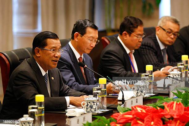 Cambodia's Prime Minister Hun Sen sits with his delegation as he speaks during a meeting with China's President Xi Jinping on the sidelines of the...