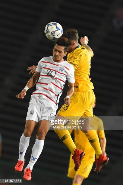 Cambodia's Yeu Muslim fights for the ball with Australia's Aiden O'Neill during the Tokyo 2020 Olympic Games men's Asian qualifier football match...