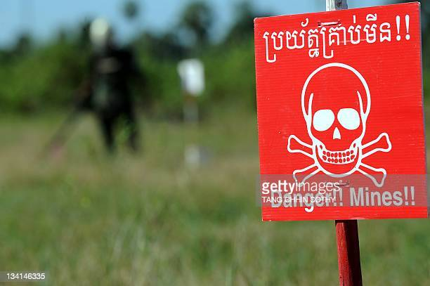 CambodiaweaponslandminestreatyFOCUS by Suy Se A Cambodian deminer scans for mines at the Training and Mine Unexploded Ordnance Clearance Center in...