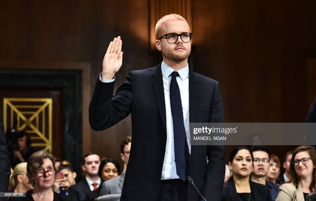 TOPSHOT - Cambridge Analytica former employee and whistleblower Christopher Wylie is sworn in before he testifies at the Senate Judiciary Committee on Cambridge Analytica and data privacy in the Dirksen Senate Office Building on Capitol Hill in Washington, DC on May 16, 2018.