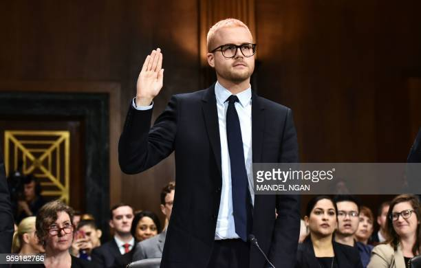 Cambridge Analytica former employee and whistleblower Christopher Wylie is sworn in before he testifies at the Senate Judiciary Committee on...