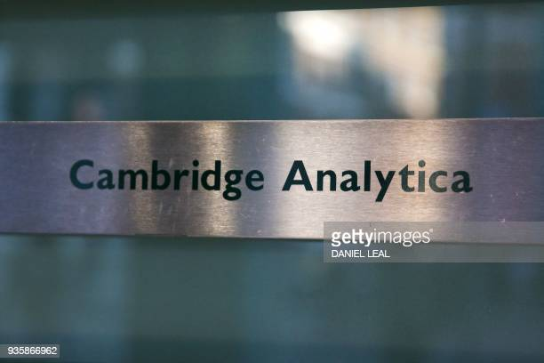 A Cambridge Analytica sign is pictured at the entrance of the building which houses the offices of Cambridge Analytica in central London on March 21...