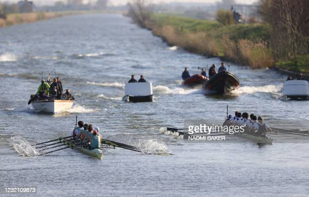 Cambridge beat Oxford at the finish of the 166th annual men's boat race between Oxford University and Cambridge University on the River Great Ouse in...