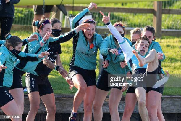 Cambridge cox Dylan Whitaker is thrown into the river after their win over Oxford in the 75th annual women's boat race between Oxford University and...