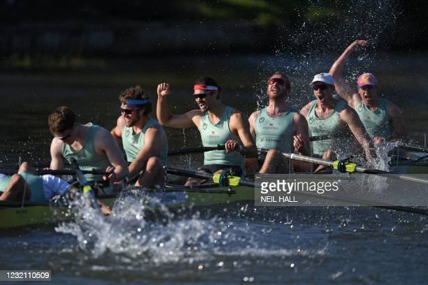 Cambridge crew celebrate their win over Oxford at the finish of the 166th annual men's boat race between Oxford University and Cambridge University...