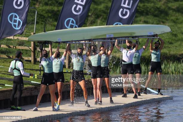 Cambridge crew leave the water after victory over Oxford in the 75th annual women's boat race between Oxford University and Cambridge University on...