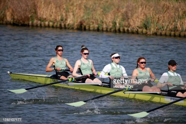 Cambridge crew warm up ahead of the 75th annual women's boat race between Oxford University and Cambridge University on the River Great Ouse in Ely,...