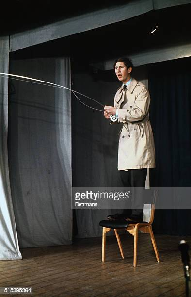 Prince Charles fishes from a chair during a skit in the Cambridge University revue Charles appears in four roles in the student production It is the...