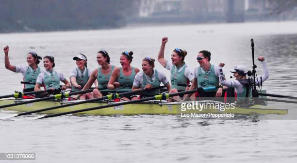 Cambridge ladies crew celebrate winning by 8 lengths at the finish after the University Women's Boat Race between Oxford v Cambridge on the River...