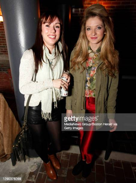 Cambridge, MA - Kellie Shaw and Regina Case both from England but currently working in Chatham, wait for the start of the Jessie Ware show at The...