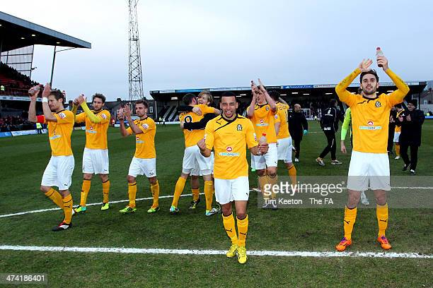 Cambridge players celebrate after the final whistle during the FA Trophy Semi Final Second Leg match between Grimsby Town and Cambridge United at...