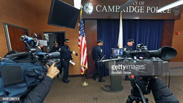Cambridge Police Commissioner Branville G Bard Jr second from left walks into the room with other department officials for a press conference at...