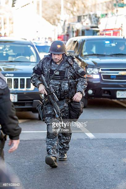 Cambridge Police SWAT team member walks down Quincy St towards Harvard Yard following a bomb threat that was made on campus on November 16 2015 in...