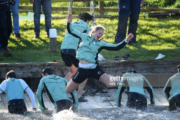 Cambridge rower Sophie Paine jumps into the river after their win over Oxford in the 75th annual women's boat race between Oxford University and...
