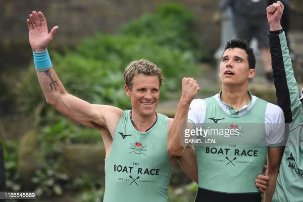 Cambridge rowers British rower James Cracknell and British rower Callum Sulivan celebrate their win at the finish of the 165th annual men's boat race...