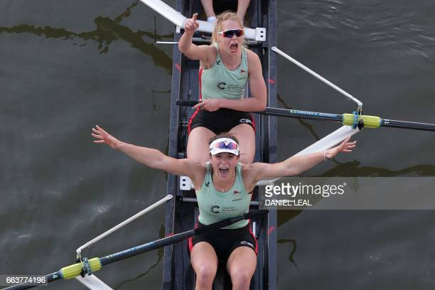 Cambridge rowers Claire Lambe and Anna Dawson celebrate winning the annual women's boat race between Oxford University and Cambridge University on...