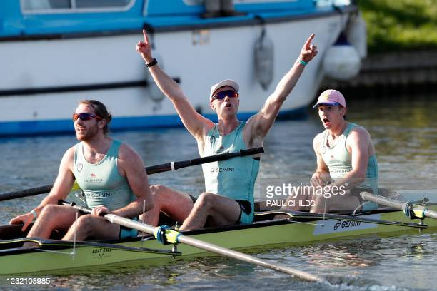 Cambridge rowers Seb Benzecry, Ben Dyer and Theo Weinberger celebrate their win over Oxford at the finish of the 166th annual men's boat race between...