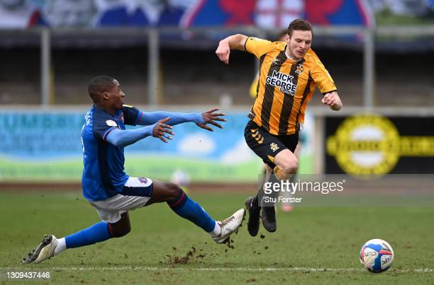 Cambridge striker Paul Mullin is fouled by Carlisle defender Aaron Hayden during the Sky Bet League Two match between Carlisle United and Cambridge...
