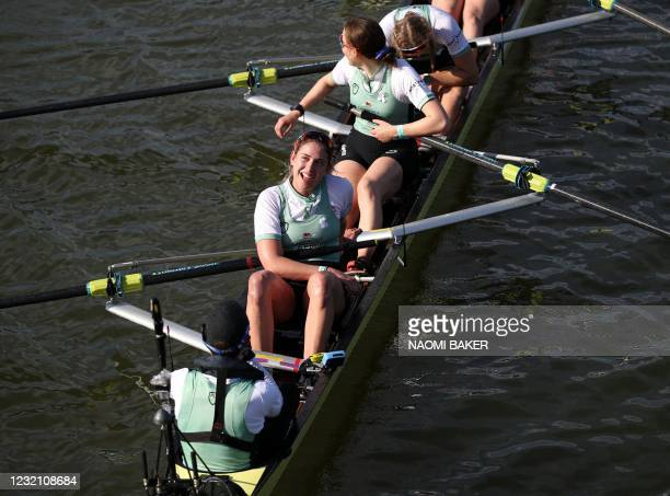 Cambridge stroke Sarah Tisdall smiles as her crew celebrate their win over Oxford in the 75th annual women's boat race between Oxford University and...