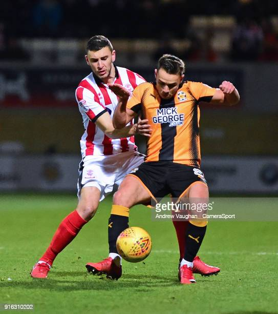 Cambridge United's Billy Waters is fouled by Lincoln City's James Wilson during the Sky Bet League Two match between Cambridge United and Lincoln...