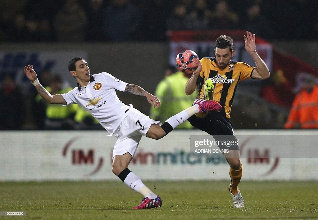 Cambridge United's Emglish midfielder Tom Champion (R) vies for the ball with Manchester United's Argentinian midfielder Angel Di Maria during the FA Cup fourth round football match between Cambridge United and Manchester United at The R Costings Abbey Stadium in Cambridge on January 23, 2015. AFP PHOTO / ADRIAN DENNIS == RESTRICTED TO EDITORIAL USE. No use with unauthorized audio, video, data, fixture lists, club/league logos or live services. Online in-match use limited to 45 images, no video emulation. No use in betting, games or single club/league/player publications. ==