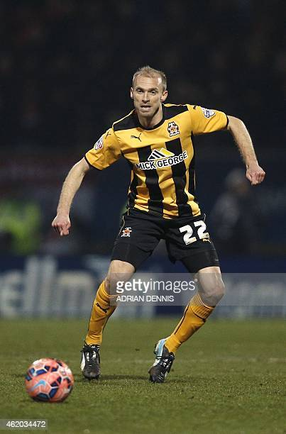 Cambridge United's English midfielder Luke Chadwick former Manchester United player runs for the ball during the FA Cup fourth round football match...
