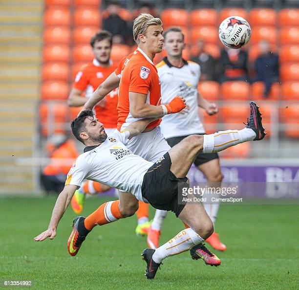 Cambridge United's Piero Mingoia clears his lines under pressure from Blackpool's Brad Potts during the Sky Bet League Two match between Blackpool...