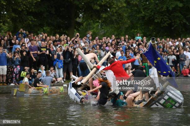 Cambridge University students in boats made from cardboard float down the River Cam in Cambridge on the Suicide Sunday part of the annual traditions...