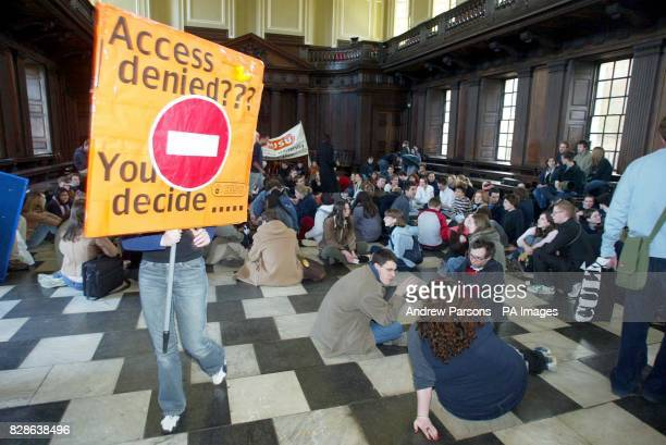 Cambridge University students recalled protests of the past by staging a sitin in opposition to Government plans to introduce topup fees * About 100...
