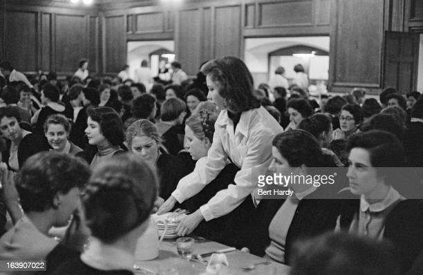 Cambridge University undergraduates dining in Hall at Girton College March 1957 Girton was England's first residential college for women Original...