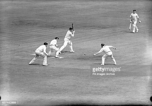 Cambridge University's Roger Prideaux edges the ball through the slips past MCC's Bill Edrich and Raman Subba Row