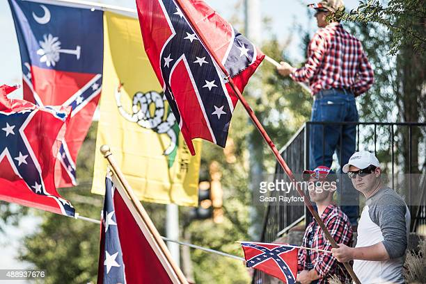 Camden George and George Stumbo hold Confederate battle flags outside the Heritage Action Presidential Forum September 18 2015 in Greenville South...