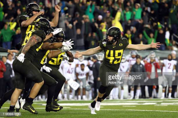 Camden Lewis of the Oregon Ducks celebrates with teammates after kicking the game winning field goal to defeat the 3735 during their game at Autzen...