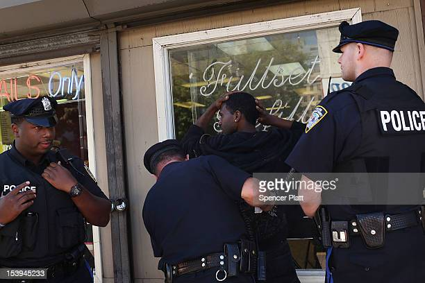 Camden police arrest a youth following a fight on October 11, 2012 in Camden, New Jersey. According to the U.S. Census Bureau, Camden, New Jersey is...