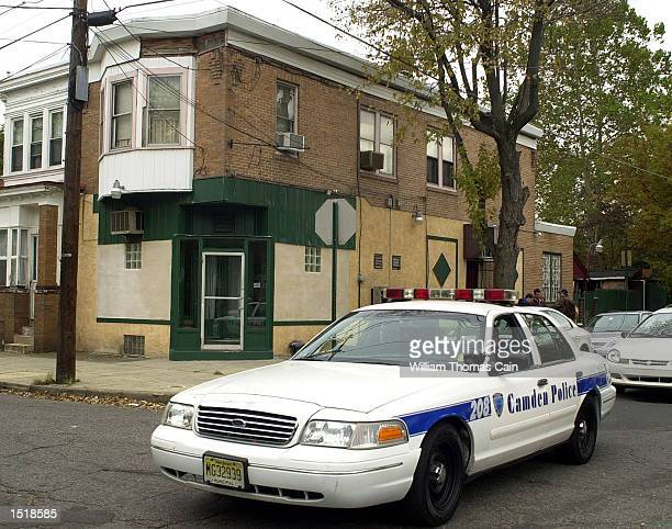 Camden police cruiser passes 1400 Sheridan St. Where sniper suspect John Allen Muhammad had his blue Chevy Caprice that he was in when arrested in a...