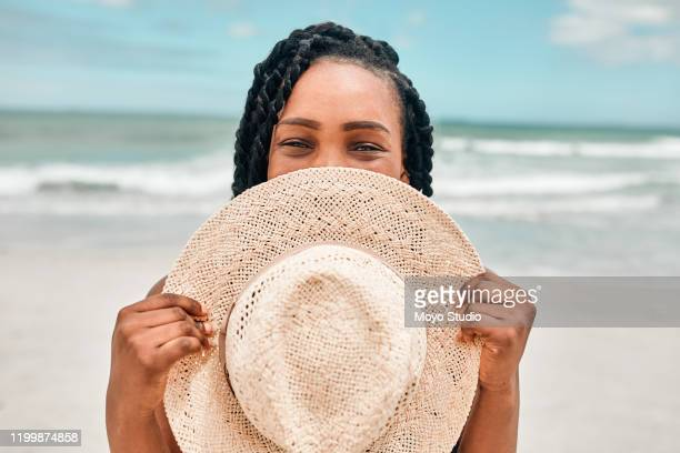 i came prepared to the beach with my most stylish hat - sun hat stock pictures, royalty-free photos & images