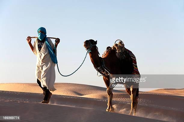 Camel driver in the Sahara desert Tunisia