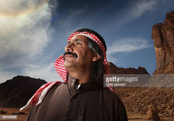 A camel handler poses for a photograph in Wadi Rum on October 12 2008 in Petra Jordan The sandstone in the region has given rise to unique rock...