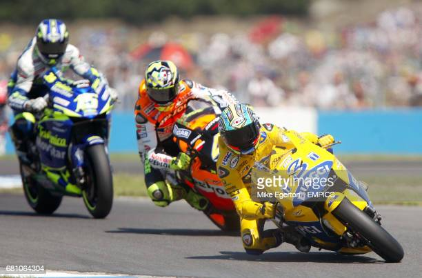 Camel Pramac Pons' Max Biaggi leads Repsol Honda's Valentino Rossi on his way to winning the British Grand Prix
