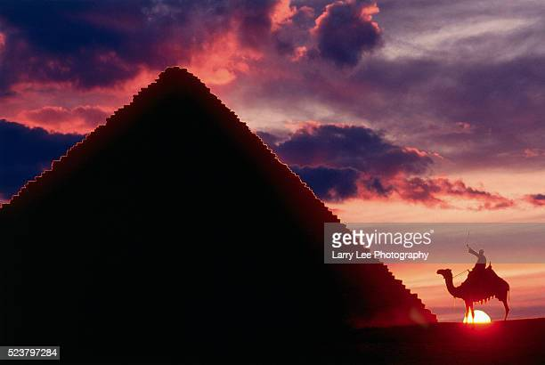 Camel Rider by Great Pyramid at Sunset