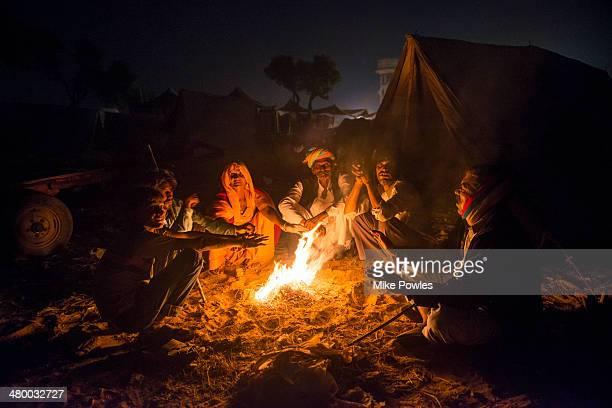 Camel traders, warming around fire, Pushkar, India