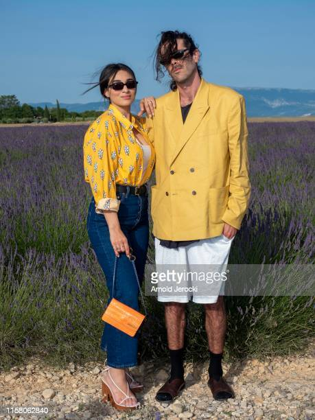 Camelia Jordana and guest attends the Jacquemus Spring Summer 2020 show on June 24, 2019 in Valensole, France.